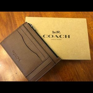 Coach leather small zippered wallet.